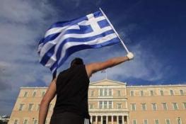 EURO BÖLGESİ YUNANİSTAN'IN KREDİ DİLİMİNİ ONAYLADI